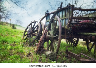 Old rustic disabled wagon lying in the fields