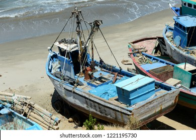 Old rustic fishing boats in Mancora, Peru on a sunny day