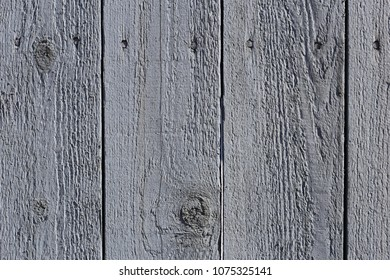 Old rustic grey plank wall. Interesting pattern and texture created with old painted planks. Photo taken in old town Porvoo, Finland.