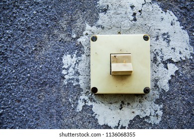 Old rustic Light Switch on vintage wall with copy space