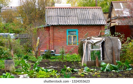 Old rustic red brick house in Russia.