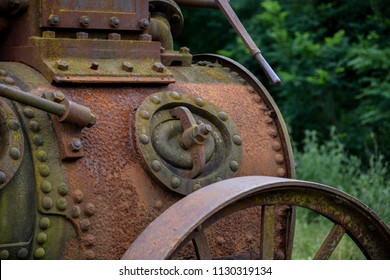 Old and rustic steam train or tractor used in Serbia in 1920's and 1930's. Made in Germany. Old fashioned steam tractor standing in a field. Old Vintage Steel Wheel Farm tractor.