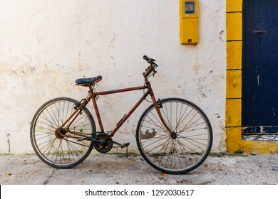 Old rustic vintage bicycle on the street near the color wall. Travel concept. Bike ride. Postcard. Copy space.