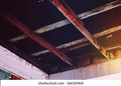 Old Rustic Wooden Cross Beam Rafters from an Old Abandoned Building