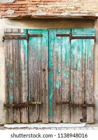 Old rustic wooden door, Italian street, textured background