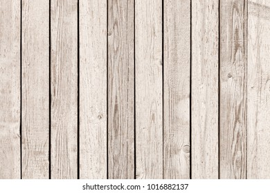 Old rustic wooden fence painted into white years ago - outdoors shot
