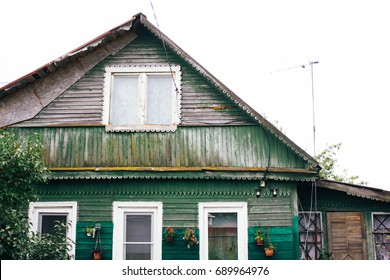 Old and rustic wooden house in the village of grandmother. green boards in retro style