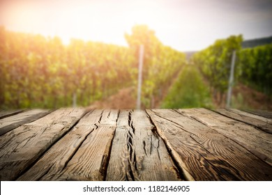 old rustic wooden table in the vineyard