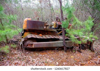Old rusting abandon bulldozer in the forest