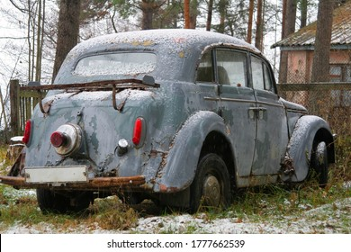 Old rusty abandoned car in the forest. Lost Old russian auto