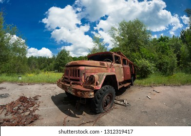 Old rusty abandoned Soviet fire truck in Chernobyl exclusion zone.