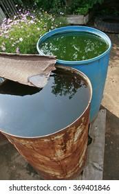 old rusty barrels with rain water