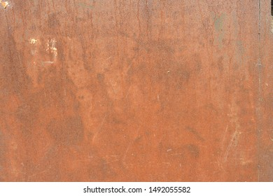 Old rusty and battered metal background.