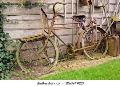 Old rusty bicycle as a decoration in a garden