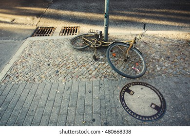 Old rusty bicycle lying on the street
