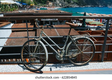 Old rusty bicycle parked at bright sunny summer day.