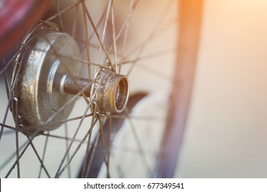 Old rusty bicycle wheel, close-up