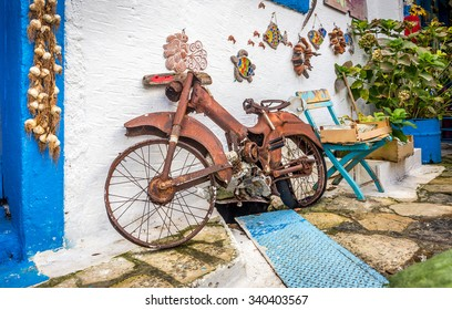 Old rusty bike used as decoration at greek Zia village, Greece