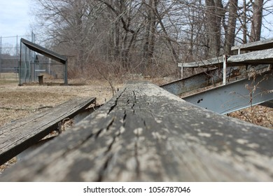 Old rusty bleacher spectator seats at abandoned sports field