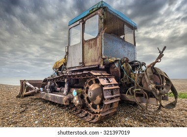 Old rusty bulldozer used for launching fishing boats