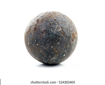 Old rusty cannon ball shot on white