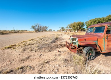 Old rusty car in abandoned town along historic US Route 66, Texas