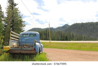 Old rusty car by the road