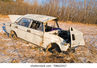 The old rusty car crashed in the accident costs in the field