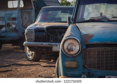 old rusty car in a junkyard