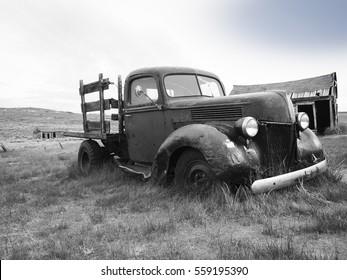 Old rusty car in prairie grass desert,Bodie Ghost Town California,USA