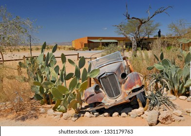 Old and rusty car wreck at the last gas station before the Namib desert. Solitaire, Namibia.