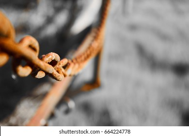 Old rusty chain selectively colored with grey background