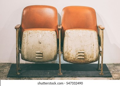 Old rusty cinema chair, with nobody, in vintage color