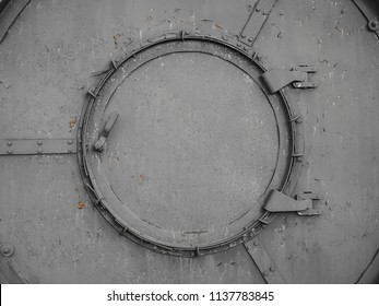 Old rusty еntrance door or hatch with gray peeling paint to the soviet fallout shelter