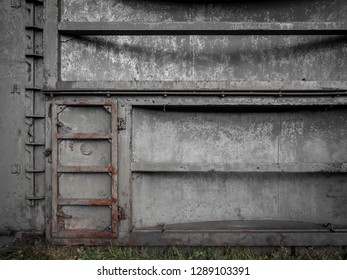 Old rusty еntrance door or hatch with gray peeling paint to the soviet fallout shelter. Bunker door.