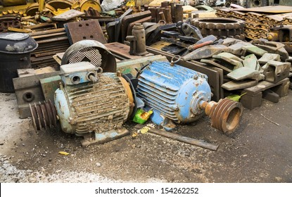 old rusty electric motors in junkyard
