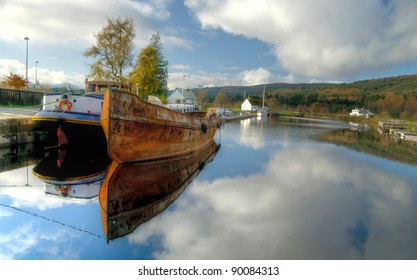 Old rusty fishing boat anchored on Caledonian channel in Scotland