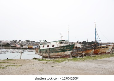 old rusty fishing boats abandoned at the atlantic ocean in France