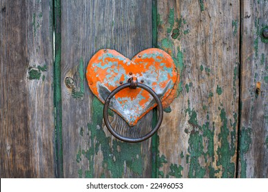 Old rusty gate latch on the wooden door