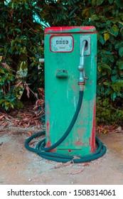 old rusty green gasoline pump
