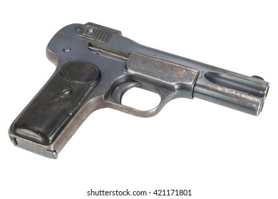 Old rusty handgun early 20th century isolated on white