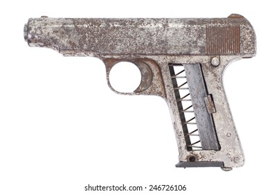 Old rusty handgun isolated on white