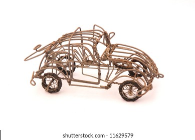 An old rusty handmade car made out of wire isolated on white background. This vehicle is an African art holiday souvenir from South Africa.