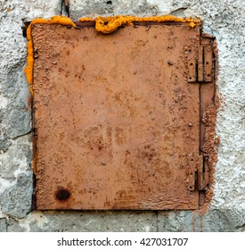 Old Rusty Hatch on The Wall
