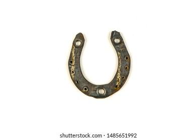 Old rusty horseshoe on a white background.