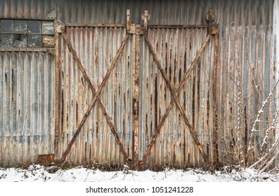 An old rusty industrial metal doors