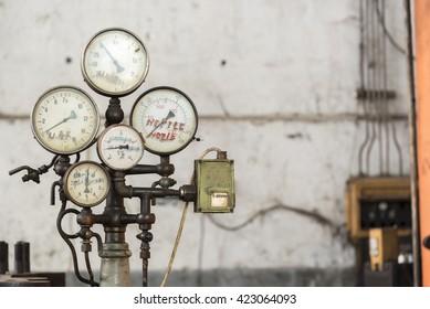 Old rusty industrial oil press gauges