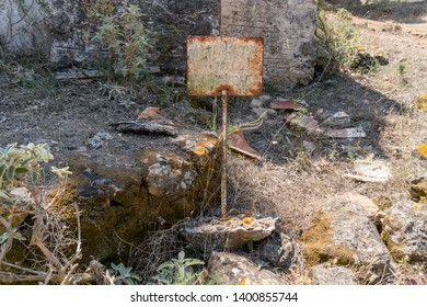 old rusty information sign in a ruin