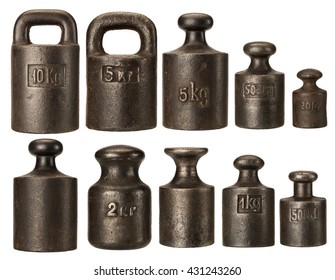 Old rusty iron scale weights isolated on white