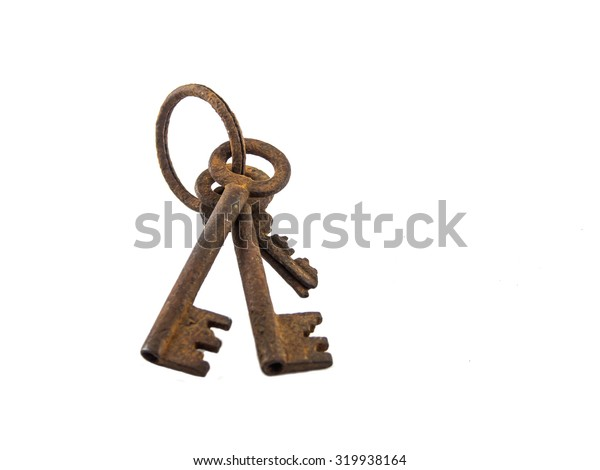 The old rusty key of white background.